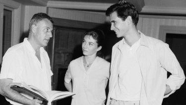 Stanley Kramer (left), Donna Anderson and Anthony Perkins on set.