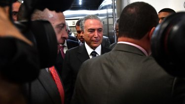 Booed at the opening and closing ceremonies and now under investigation for corruption: Brazilian President Michel Temer.