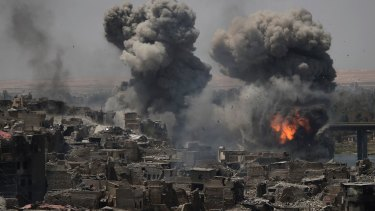 """Air strikes target Islamic State positions on the edge of the Old City a day after Iraq's prime minister declared """"total victory"""" in Mosul."""