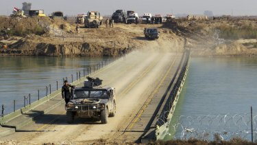 Iraqi forces cross the Euphrates in the advance to Ramadi.