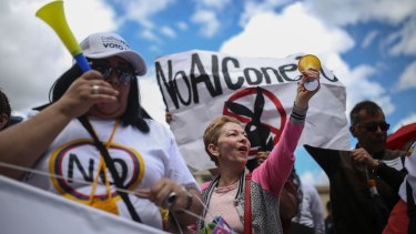 Opponents of the peace agreement also gathered outside Congress in Bogota.