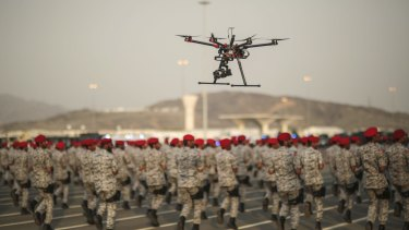A drone is used to record a military parade by Saudi security forces in preparation for the annual Hajj pilgrimage in Mecca, Saudi Arabia. Saudi Arabia is one of the US's biggest weapons buyers.