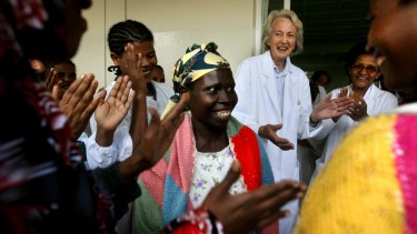 Dr Catherine Hamlin celebrates with staff and cured patients who are heading home after treatment.