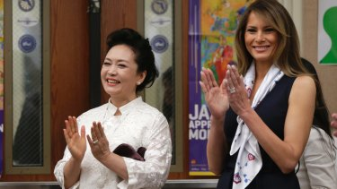US first lady Melania Trump and her Chinese counterpart Peng Liyuan enjoy a musical performance at the Bak Middle School of the Arts, in West Palm Beach, Florida on Friday.