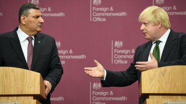 Boris Johnson, seen here with Syrian opposition leader Riyad Hijab earlier this week, has backed the opposition's proposals for a transition in the war-torn nation.