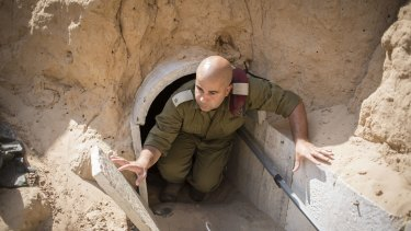 An Israeli soldier inside a tunnel built by Hamas militants leading from the Gaza Strip into southern Israel in 2014.