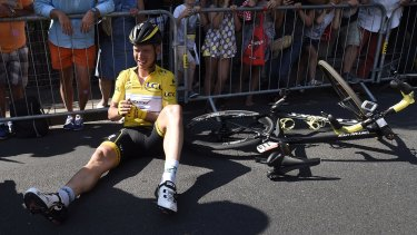 Germany's Tony Martin, wearing the overall leader's yellow jersey, lies on the road with a broken collarbone after crashing in the last kilometers of the sixth stage of the Tour de France.