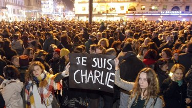 Demonstrators hold a banner reading 'I am Charlie', at the Old Port of Marseille, southern France.