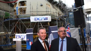 Minister for Defence Industry Christopher Pyne, and DCNS chief executive Herve Guillou, at the shipyards in Cherbourg, western France