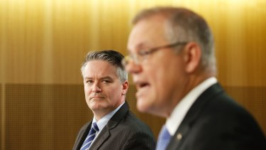 """""""Payments for onshore compliance and detention numbers for the strong and effective control of our borders are lower than expected,"""" said Finance Minister Mathias Cormann."""