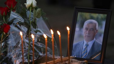 Flowers, candles and a picture of Kosovo Serb politician Oliver Ivanovic, at the spot where he was shot dead on Tuesday.