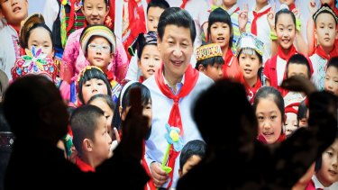 A picture of Xi Jinping with children at an exhibition highlighting China's achievements under five years of his leadership