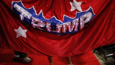 A delegate wears a Trump cape on the third day of the convention.
