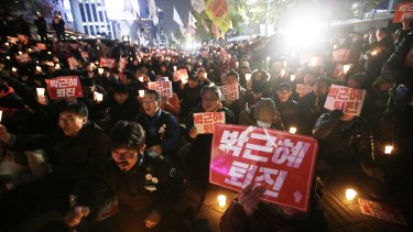 Protesters call on South Korean President Park Geun-hye to resign.