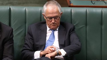 Communications Minister Malcolm Turnbull with his Apple Watch in Parliament.