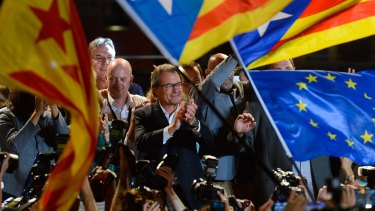 Catalan regional president Artur Mas (centre) celebrates as the Catalan coalition Junts pel Si (Together for the Yes) claims victory in the regional elections  in Catalonia.