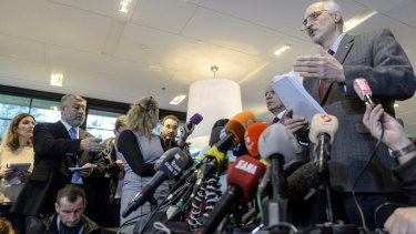 The Syrian government's chief negotiator and the country's ambassador to the UN, Bashar Jaafar, addresses the media in Geneva.