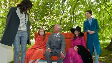 Prince Charles with models wearing wool in 2014.