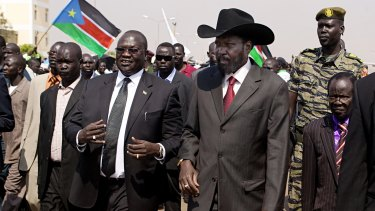 South Sudanese President Salva Kiir, centre-right, greeted by then vice-president Riek Machar, centre-left, in Juba in 2011.