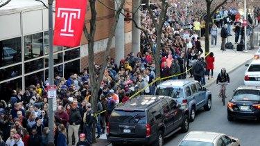 People wait in line to see Democratic presidential hopeful Bernie Sanders at Temple University in Philadelphia.