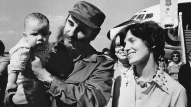 In this 1976 photo, Margaret Trudeau smiles as Cuban President Fidel Castro holds her youngest son Michel after the Trudeaus arrived in Havana, Cuba.