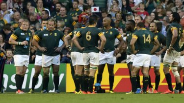 In deep: South Africa's stunned players after they were beaten by Japan.