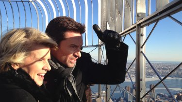 Dinner with Foreign Minister Julie Bishop and actor Hugh Jackman, pictured at the top of the Empire State Building in New York, received a winning bid of $35,500.