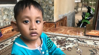 Rizki Ashadi, who is five, does not speak, and still wears a nappy.