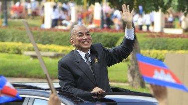 Cambodia's King Norodom Sihamoni waves to students during the Independence Day celebrations in Phnom Penh last week.