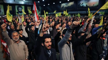 Supporters of the Lebanese Shiite party Hezbollah cheer as they listen to a speech by their leader Hassan Nasrallah in Beirut in February.