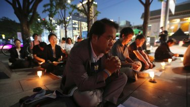 People pray during a service for peace on the Korean Peninsula near the US Embassy in Seoul, South Korea, on Thursday.