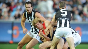 Magpie mauling: Jack Watts is crunched in that first tackle on his Melbourne debut in 2009.