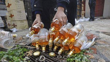 Bottles of confiscated fake whisky seized in Wuhan, China, in 2012.