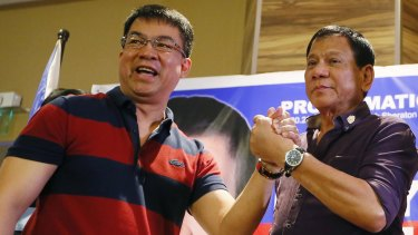 "Mayor Rodrigo Duterte, right,  is officially declared the presidential candidate of the PDP-Laban political party by its president, senator Aquilino ""Koko"" Pimentel, in November last year."
