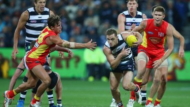 Cats skipper Joel Selwood makes a break during the match against Gold Coast on Sunday.