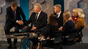 Bjarni Benediktsson of the Independence Party, left, shakes hands with then Iceland's Prime Minister Sigurdur Ingi Johannsson in a TV studio last year.
