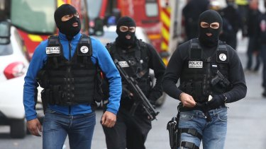 Police during the Saint Denis operation on the outskirts of Paris.