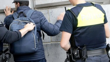 Police officers search a backpack at Antwerp Central train station in Antwerp, Belgium on Saturday.