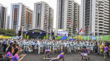 Team Australia is welcomed to the athletes' village at the start of the Olympics.