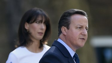 Britain's Prime Minister David Cameron announces his resignation following the Brexit vote as his wife Samantha looks on.