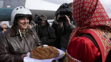 A Russian pilot who returned from Syria is welcomed with traditional bread and salt at an airbase near Voronezh.