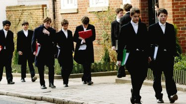 Tailcoats and starched collars: Pupils at Eton College, England hurry between lessons in 2004.