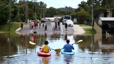 Michael and Caleb Eadie made the most of the flooding at Kokoda Street, Beenleigh.
