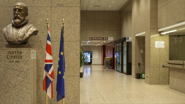 The Union Jack hangs between a EU flag and a bust of Justus Lipsius, Flemish philologist and humanist, at the headquarters of the Council of the European Union in Brussels.