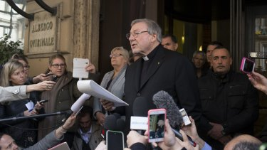 Cardinal Pell reads a statement after meeting victims of abuse in Rome last month.