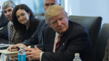 Donald Trump with (from left) Larry Page, Sherryl Sandberg and Mike Pence, listens in the direction of Tim Cook at the meeting on Wednesday.
