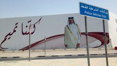 "An image of Qatar's emir, Sheikh Tamim bin Hamad Al Thani, graces a billboard featuring the slogan ""We are all Tamim"" in Doha, Qatar, on Monday."
