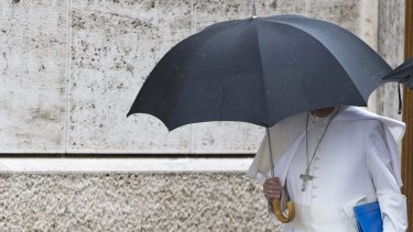Pope Francis arrives for the afternoon session of the synod of bishops at the Vatican on Saturday.