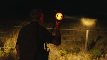 Williams spotlights for thylacines near Tassie Tiger Lodge.