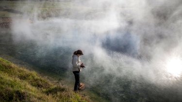 Princeton student Rachel Harris collects microbes from a hot spring in western South Africa.